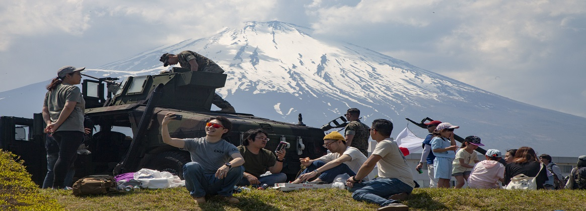 Festival attendees relax during the Friendship Festival May 11, 2019, on Combined Arms Training Center Camp Fuji, Shizuoka, Japan. The festival is one of the largest community relations events the Marine Corps hosts in Japan. (U.S. Marine Corps photo by Pfc. Karis Mattingly)