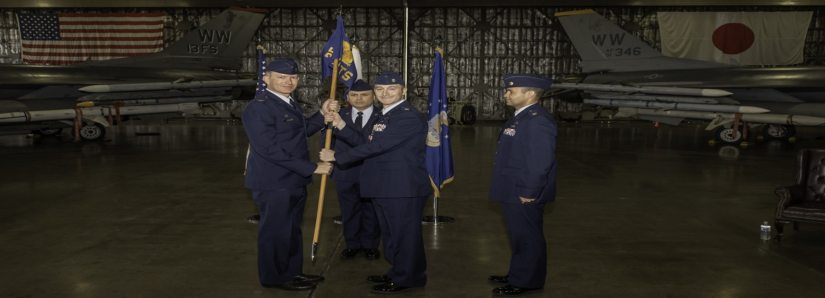 U.S. Air Force Lt. Col. Ryan Carville, changes command of the 35th Comptroller Squadron with Maj. Anthony George, at Misawa Air Base, Japan, May 14, 2019. Col. Kristopher Struve, the 35th Fighter Wing commander, presided over the ceremony. George's previous assignment was the commander of the 325th Comptroller Squadron at Tyndall Air Force Base, Florida. Carville and his family head to Peterson Air Force Base, Colorado. (U.S. Air Force photo by Tech. Sgt. Benjamin W. Stratton)