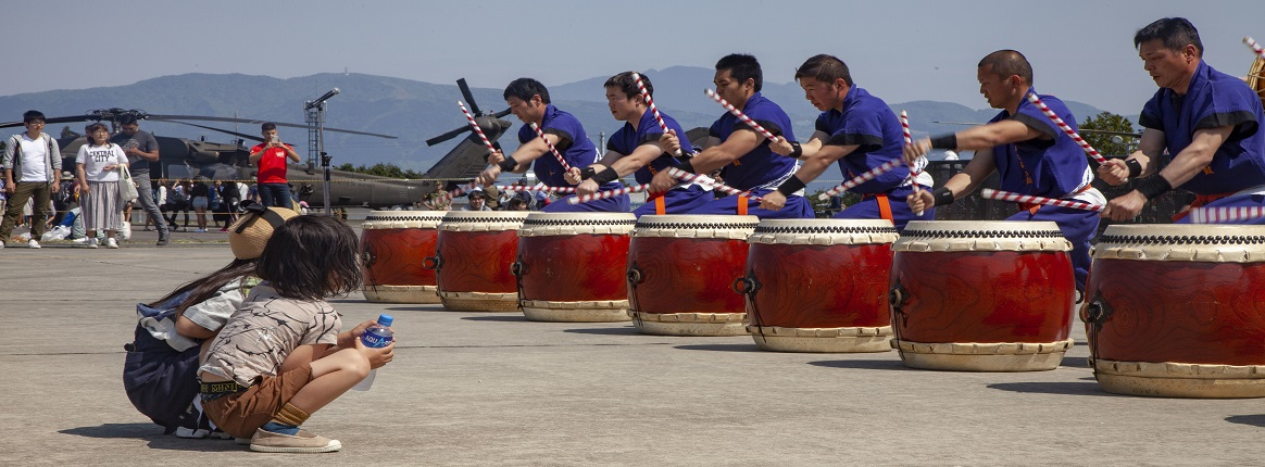 Children watch the Takigahara Taiko Drummers play for the Friendship Festival May 11, 2019, on Combined Arms Training Center Camp Fuji, Shizuoka, Japan. Festival attendees were able to tour static displays, interact with Japan Ground Self-Defense Force and U.S. service members, and enjoy live entertainment. (U.S. Marine Corps photo by Pfc. Karis Mattingly)