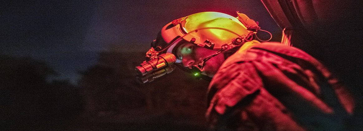 Air Force Tech. Sgt. Nicholas Poe performs a visual confirmation with night vision goggles before taking off from a landing zone at Combined Arms Training Center Camp Fuji in Shizuoka, Japan, June 4, 2019.