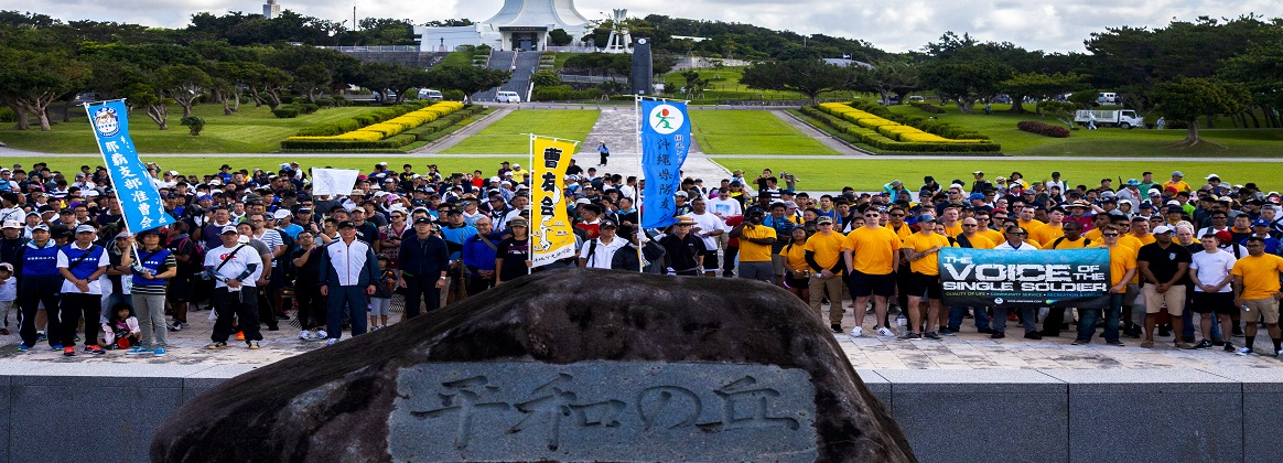 Members of the Japan Self-Defense Force and U.S. military pose for a photo during a cleanup June 15 at Peace Memorial Park, Okinawa, Japan. The cleanup was done in preparation for Okinawa Memorial day, June 23, where many families come to Peace Memorial Park to honor the fallen soldiers from the Battle of Okinawa. (U.S. Marine Corps photo by Pfc. Jacob Foster)