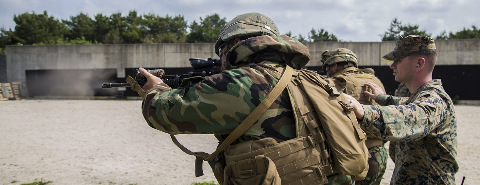 U.S. Marines with Headquarters Battalion, 3d Marine Division, engage the Table 5 course of fire in Mission Oriented Protective Posture gear Level 1 during III Marine Expeditionary Force Exercise (MEFEX) on Range 160, Camp Hansen, Okinawa, Japan, April 25, 2017. MEFEX serves as a simulated war exercise meant to strengthen the capabilities of the Marine Expeditionary Force and Division levels.