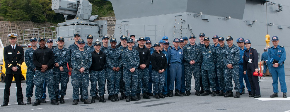 Sailors assigned to the Navy's only forward deployed aircraft carrier, USS Ronald Reagan (CVN 76), pose for a photo with Japanese Sailors assigned to JS Izumo (DDH 183) on Izumo's flight deck. Twenty Sailors from Ronald Reagan toured Izumo as part of a partnership event. Ronald Reagan, the flagship of Carrier Strike Group 5, provides a combat-ready force that protects and defends the collective maritime interests of its allies and partners in the Indo-Asia-Pacific region.