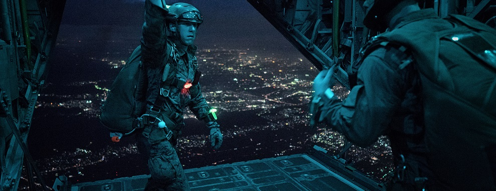 YOKOTA AIR BASE, Japan - A Marine with the 3rd Reconnaissance Battalion, 3rd Marine Division, III Marine Expeditionary Force, uses hand signals to communicate with fellow Marine jumpers in a C-130 Hercules over Yokota Air Base, Japan, May 11, 2016. The training not only allowed the Marines to practice jumping, but it also allowed the Yokota aircrews to practice flight tactics and timed-package drops. (U.S. Air Force photo by Senior Airman Delano Scott/Released)