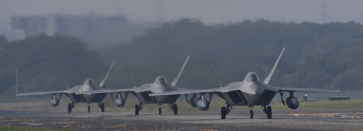 Three F-22 Raptors from Joint Base Elmendorf-Richardson, Alaska taxi down the flightline at Yokota Air Base, Japan, July 17, 2018. The F-22 raptor is a fifth-generation fighter incorporating fourth-generation stealth technology, radical maneuvering capabilities, the ability to fly at supersonic speed without afterburners and unprecedented pilot situational awareness, making it the most dominant and advanced air superiority fighter in the world.