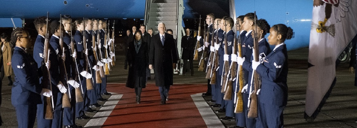 Vice President of the United States Michael R. Pence and wife Karen walk through a 374th Honor Guard cordon during his arrival at Yokota Air Base, Japan, Feb. 6, 2018. While in Japan, Pence is expected to visit Japanese officials including Prime Minister Shinzo Abe, meet with troops, and address Yokota Air Base service members before heading to South Korea for the Pyeongchang 2018 Winter Olympics.